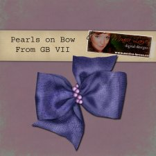 Pearls on Bow - action by Monica Larsen